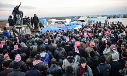 A crowd of  Syrian civilians fleeing Aleppo in Azaz on the border with Turkey.