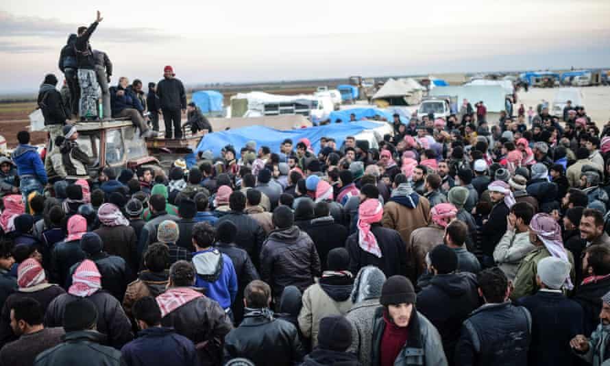 Syrians fleeing the northern city of Aleppo wait in Bab al-Salam border crossing with Turkey.