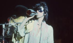 Keith Swigs On StageRolling Stones guitarist Keith Richards takes a swig of Jack onstage in 1975.
