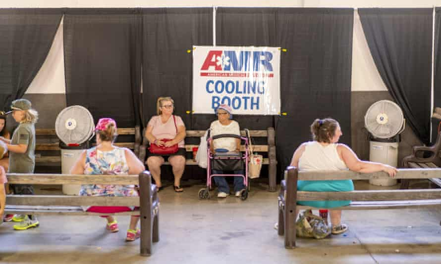 People sit inside a cooling booth at the Shasta district fair during a heatwave in Anderson, California, on 26 June 2021.