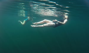 In this underwater-taken image the writer Jenny Landreth and swimmer and artist Vivienne Rickman-Poole swim in Llynnau Cwm Silyn, Snowdonia national park, Wales.