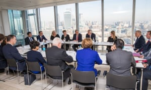 Philip Hammond (centre rear left) and David Davis (centre rear right) during a meeting with executives from the financial services at the Shard.