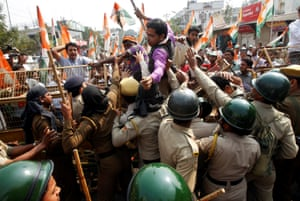 Agartala, India Demonstrators try to cross a police barricade during a protest organized by India's main opposition Congress party against demonetisation