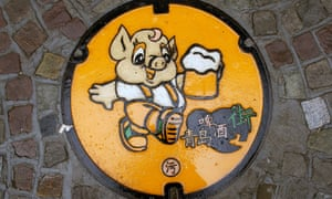 A humorous manhole cover near the Tsingtao brewery in Qingdao, China.