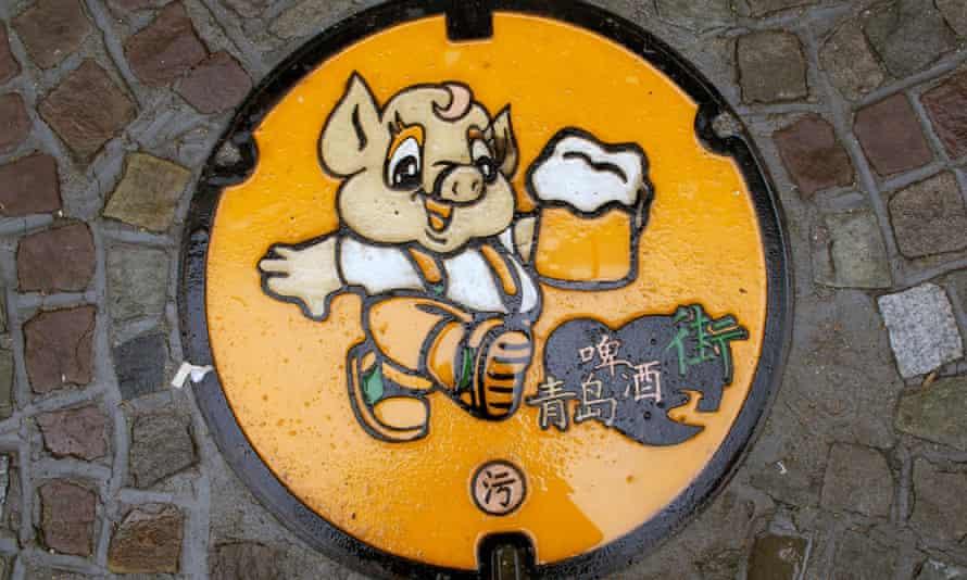 A humorous manhole cover near the Tsingtao brewery in Qingdao, China.