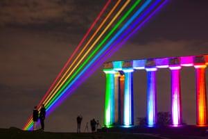 Edinburgh, Scotland Visitors are silhouetted against the lasers during a return of Burns & Beyond, Edinburgh's flagship Burns Festival