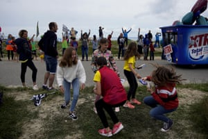 Stage 1: Children collect goods thrown from the publicity caravan before the arrival of the race