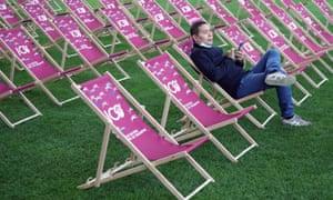 A racegoer relaxes at Longchamp.