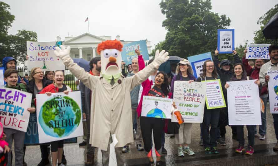Members of the Union for Concerned Scientists pose for photographs with Muppet character Beaker in front of the White House before heading to the National Mall for the March for Science on Saturday in Washington DC.