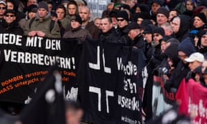 Neo-Nazis March In Magdeburg<br>MAGDEBURG, GERMANY - JANUARY 12:  Neo-Nazis stand behind a banner during the commemoration of the 1945 Allied bombing of Magdeburg on January 12, 2013 in Magdeburg, Germany. The annual march is among the biggest neo-Nazi marches of the year. German authorities have been accused of turning a blind eye to right-wing violence following revelations last year of the National Socialist Underground (NSU) neo-Nazi murder trio, who over the course of some 5 years murdered nine immigrants and one policewoman.  (Photo by Carsten Koall/Getty Images)
