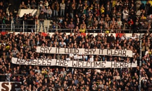 German football fans hold 'refugees welcome' banners