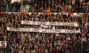 St Pauli fans unfurl a banner welcoming refugees during a match against their sellout fellow hipsters Borussia Dortmund.