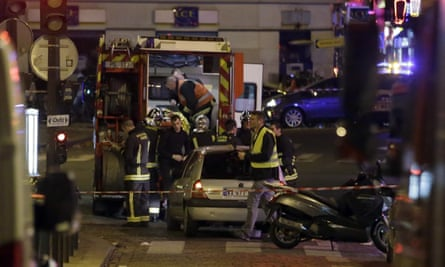 Ambulance workers in the 10th arrondissement of Paris, following a string of attacks on Friday night.