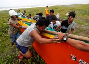 Villagers secure a boat in Aparri, Cagayan province.
