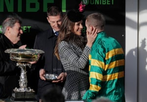 Liz Hurley congratulates Mark Walsh before presenting him with a prize for his victory on Espoir D'Allen in the Champion Hurdle.