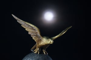 The last supermoon of 2019 rises over an eagle sculpture in New Jersey, US