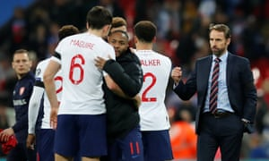 Harry Maguire, left, and Raheem Sterling embrace after defeating the Czech Republic.