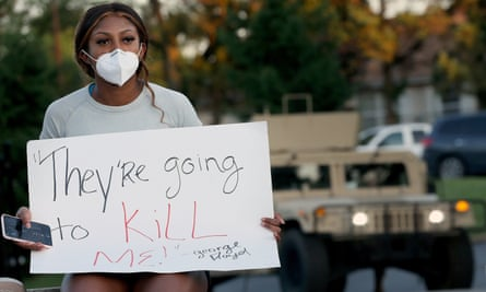 Kennedy Mitchum protests outside the Florissant police department in Missouri on 7 June.