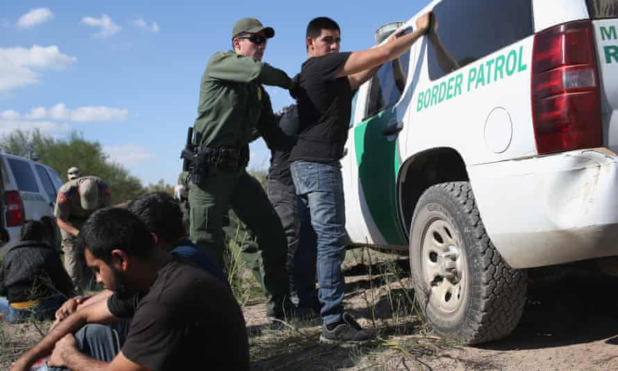 A man being searched at the US-Mexico border near Rio Grande City, Texas.