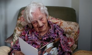 Gladys Hooper looking at a birthday card ahead of her 112th birthday.
