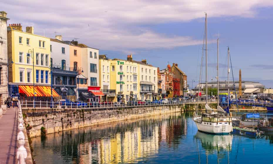 Cafes and restaurants line the quayside of Ramsgate's Royal Harbour.