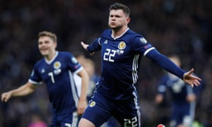 Oliver Burke celebrates scoring Scotland's late winner.