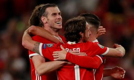 Joe Allen (front) congratulates Gareth Bale after his header gave Wales a 2-1 over Azerbaijan.