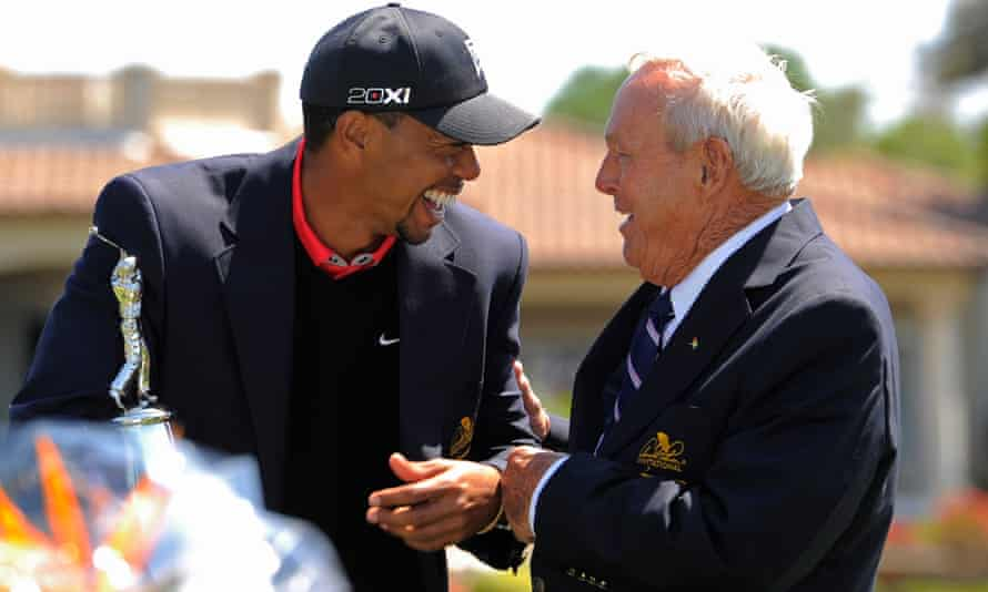 Tiger Woods and Arnold Palmer share a joke in 2013