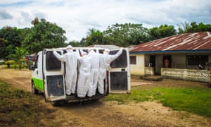 Health workers transport the body of a suspected Ebola victims in Port Loko, on the outskirts of the Serra Leonean capital Freetown, in October 2014