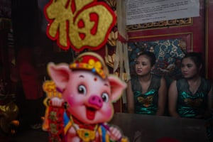 Participants prepare inside Tien Kok Sie temple during Grebeg Sudiro festival on February 3, 2019 in Solo City, Central Java, Indonesia. Grebeg Sudiro festival is held as a prelude to the Chinese New Year