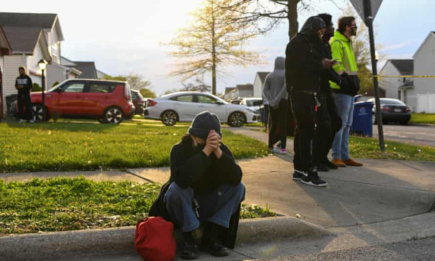 Crowds react as investigators work at the scene where 16-year-old Ma'Khia Bryant was fatally shot by a police officer in Columbus, Ohio.