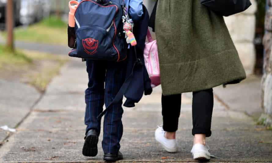 Parents collect children at St Charles' primary school at Waverley in Sydney, Australia