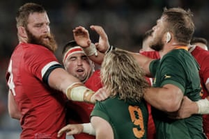 Jake Ball, left, and Wyn Jones, second left, clash with Faf de Klerk and Duane Vermeulen during the semi-final between Wales and South Africa at Yokohama International Stadium.