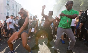 Dancing in the street at Notting Hill carnival.