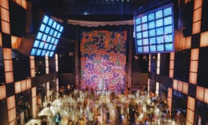 The inside of New York's Palladium with a mural by Keith Haring and a packed dance floor