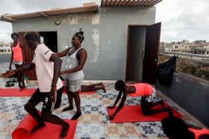 Khadjou Sambe, 25, Senegal's first female professional surfer, coaches young surfers during a fitness training session with Black Girls Surf (BGS)