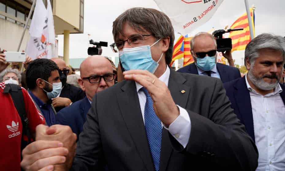 Carles Puigdemont leaves court in Sardinia on Monday 4 October after attending his extradition hearing