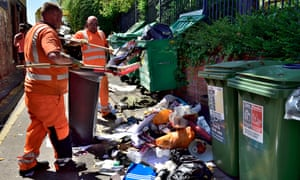City council workmen cleaning up the fly-tipped rubbish left by students at end of university term