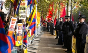 Crowds protest against the state visit by Chinese president Xi Jinping