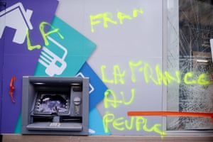'France to the People' sprayed near an ATM at a vandalised bank
