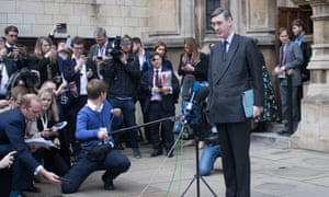 Jacob Rees Mogg speaking to reporters outside the Houses of Parliament.