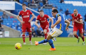 Brighton's Neal Maupay puts the penalty wide.