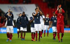 French players applaud the fans.