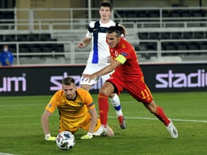 Finland's Daniel O'Shaughnessy and Lukas Hradecky watch as the ball rolls out of the reach of Wales' Gareth Bale.