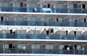 Passengers of the Diamond Princess cruise ship on their balconies at the Daikoku Pier cruise terminal in Yokohama, Japan, during the ship's quarantine