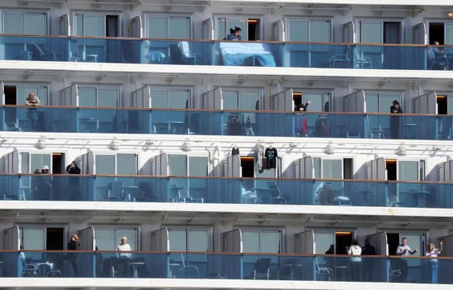 Passengers of the Diamond Princess cruise ship on their balconies at the Daikoku Pier cruise terminal in Yokohama, Japan, during the ship's quarantine