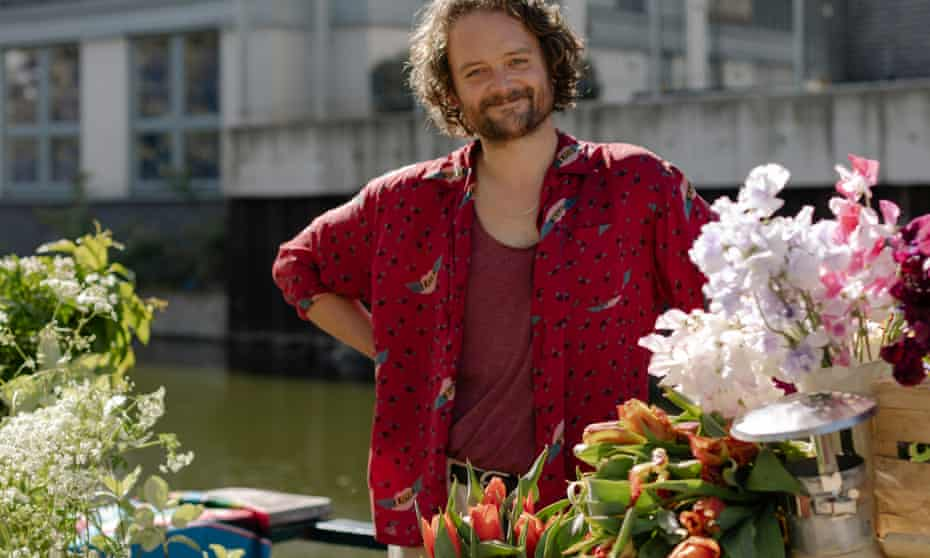 Florist Stuart Fenwick aboard his barge Bria surrounded by flowers