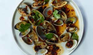 clams in a sauce on a plate