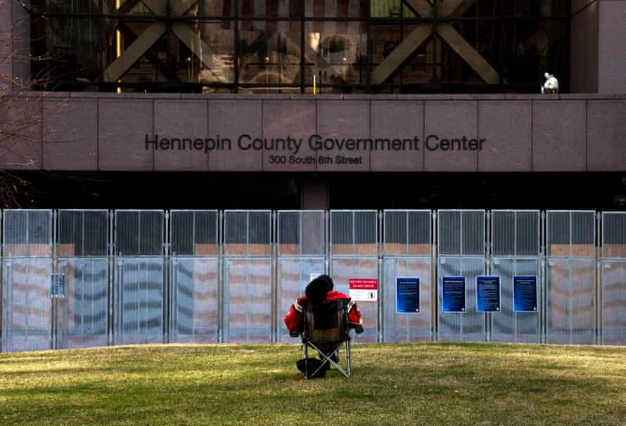 A man outside the Hennepin County Government Center in Minneapolis, Minnesota, where the Derek Chauvin trial is taking place.