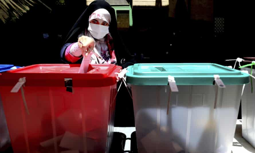 A woman casts her ballot for the Iranian presidential election at a polling station in Tehran.